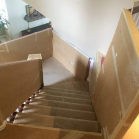 wrapped up stairs to protect them from the mess of a remodel